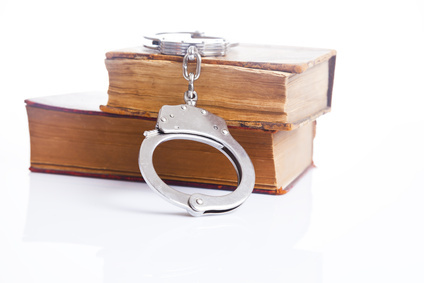 handcuffs and book of law